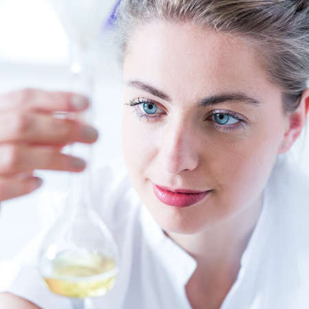 chemist: Young chemist analyzing results of chemistry experiment