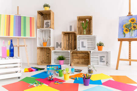 canvas art: Shot of a modern room with lots of colorful papers on the floor Stock Photo