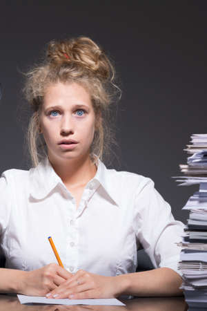 bullied: Young female bookkeeper being bullied at work
