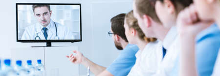 background skype: Shot of a group of doctors during a video conference Stock Photo