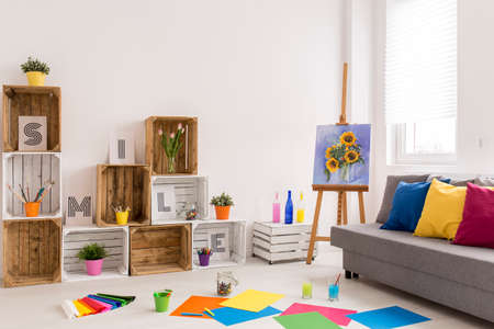 cosy: Shot of a cosy modern living room with colorful papers on the floor Stock Photo