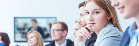 skype: Shot of a young businesswoman looking at the camera during a business meeting Stock Photo