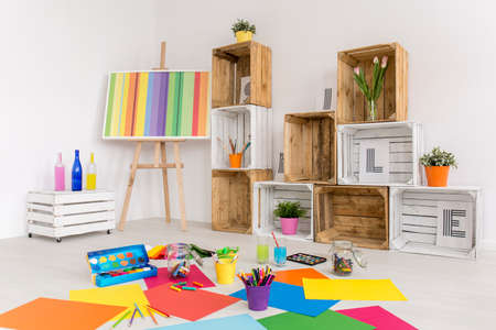 Shot of a modern room with colorful papers on the floor Reklamní fotografie