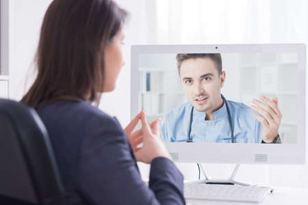 medical doctor: Young girl having an online consultation with her doctor