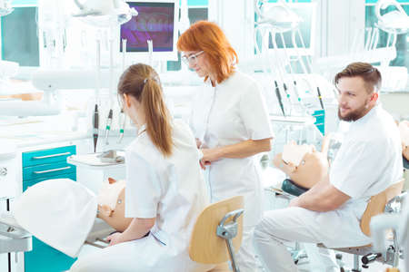 Shot of two students of dentistry and their teacher