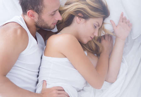 young wife: Young man is admiring his sleeping wife Stock Photo