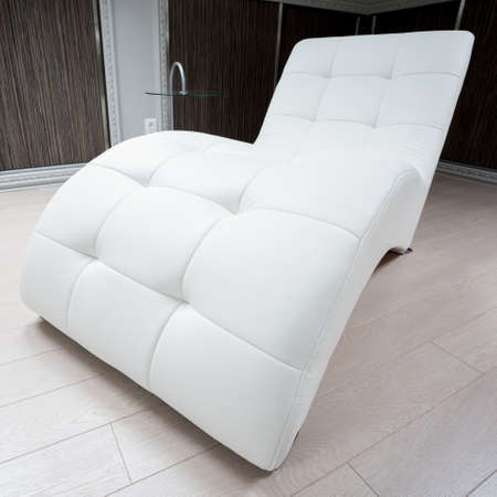 Close-up of designed couch in modern interior