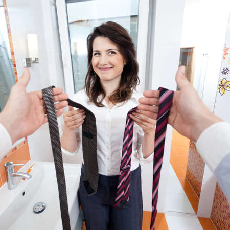 Wife choosing a tie for her man