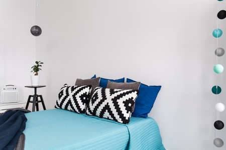 redecoration: Shot of a bed in a modern blue bedroom