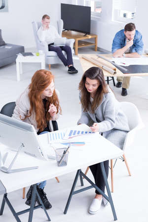 casual office: Group of young people during work at modern studio