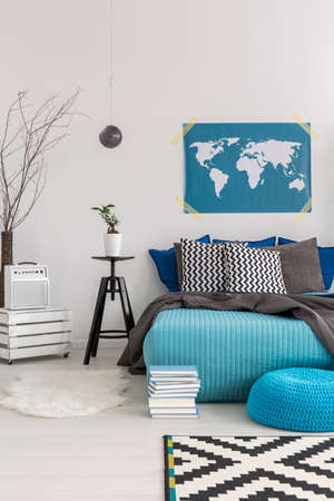 redecoration: Shot of a cosy bedroom with a map hanging on the wall