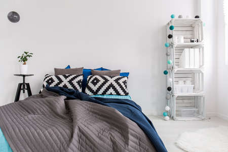cosy: Shot of a big bed in a modern cosy bedroom
