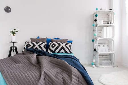 bedroom bed: Shot of a big bed in a modern cosy bedroom