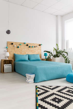 redecoration: Shot of a bed in a modern spacious bedroom