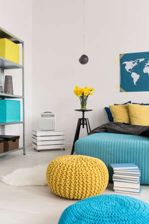 idea comfortable: Cropped picture of a modern yellow and blue bedroom Stock Photo