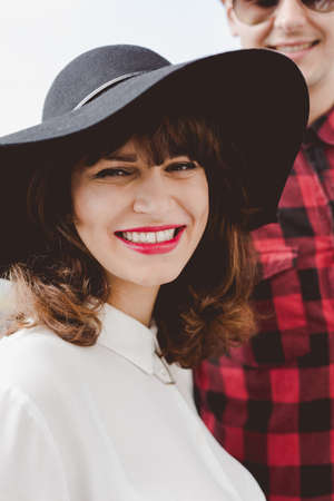 brim: Beautiful smiling woman in hat with brim