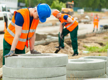 exhausted worker: Image of exhausted worker resting on construction site Stock Photo