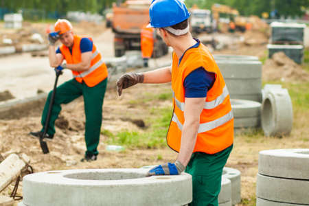 work worker: Photo of manual worker asking for help during work Stock Photo