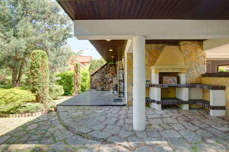 suburbs: Fireplace is outside beautiful mansion in the suburbs Stock Photo