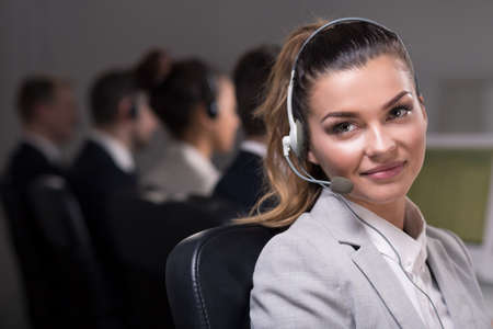 answer phone: Shot of a young call center agent ready to answer the phone Stock Photo