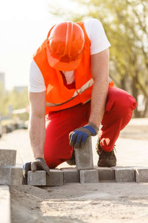 cobbles: Image of worker with cobbles building street