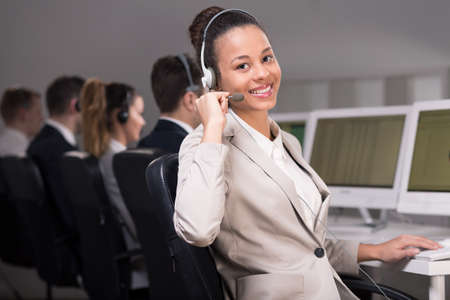 selling service: Young telemarketer during her job