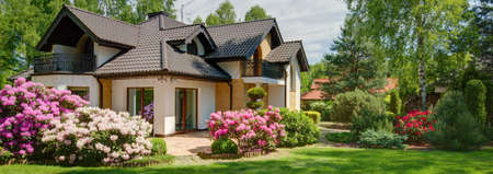 House with beautiful garden full of flowers Stok Fotoğraf - 56109277