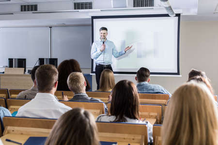 Image of a teacher giving a lecture to his students Stock Photo