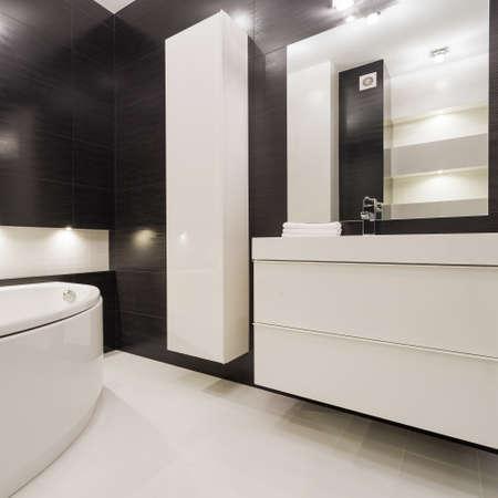 modern bathroom: Modern and exclusive black and white bathroom