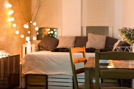 cosy: Shot of a small cosy comfortable bedroom