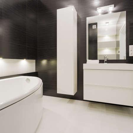 illuminated: Black and white bathroom in modern design Stock Photo