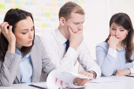 color consultation: Handsome young businessman and his two female colleagues working on new business plan Stock Photo