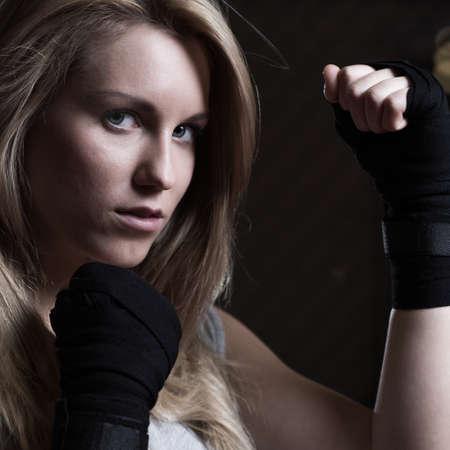 Portrait of beauty fighting girl training pugilism