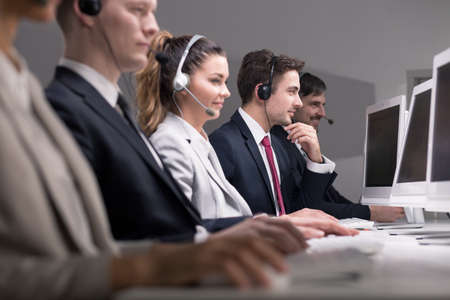 workmate: Picture of telemarketers selling their products over the phone Stock Photo