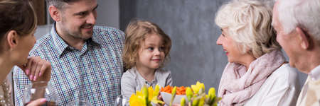 Young marriage with little daughter visiting grandparents during family dinner Imagens - 56112148