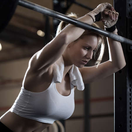tired: Close-up of woman training at crossfit center