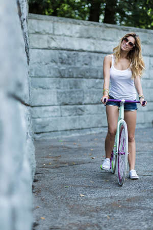 furlough: Young girl is exploring the city a bike Stock Photo