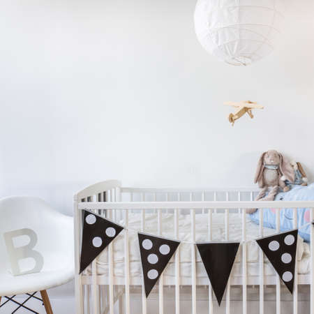 cot: Image of white baby cot with decoration