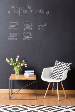interior shot: Shot of a modern cosy interior with a coffee menu on a chalkboard wall