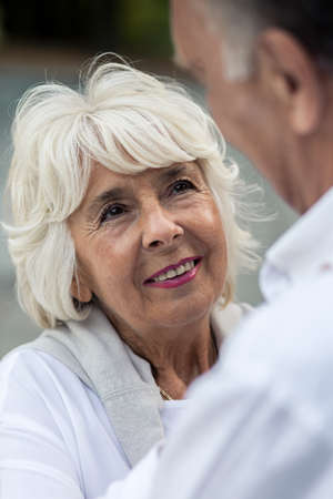 tenderly: Elderly couple looking tenderly at each other Stock Photo