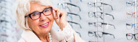 happy senior: Senior businesswoman happy with her new glasses Stock Photo