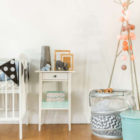 small table: Picture of crib and small table with infant accessories