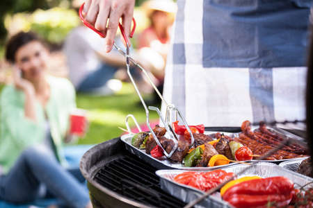 yard: Preparing food for a vegetarian during barbecue Stock Photo