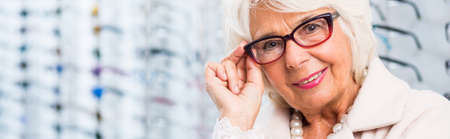 shortsightedness: Senior lady is wearing black rimmed glasses