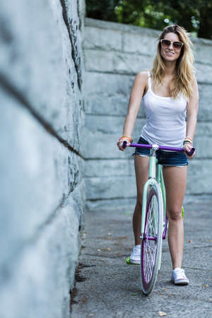furlough: Active young girl likes riding a bike Stock Photo