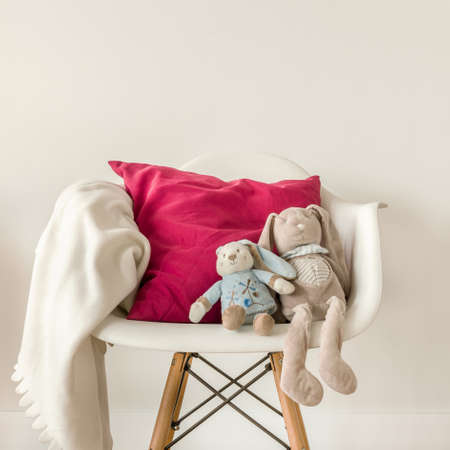 home accessories: Picture of infant accessories on white modern chair