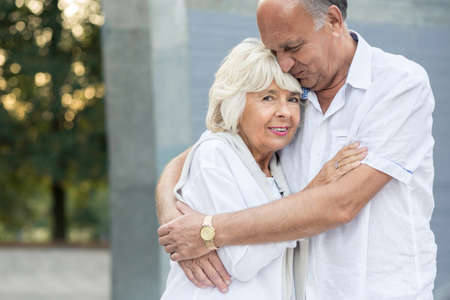 vicinity: Happy senior marriage hugging tenderly each other