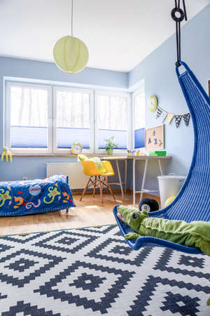 big bin: Modern schoolboys room arranged in blue and white, with lots of practical accessories