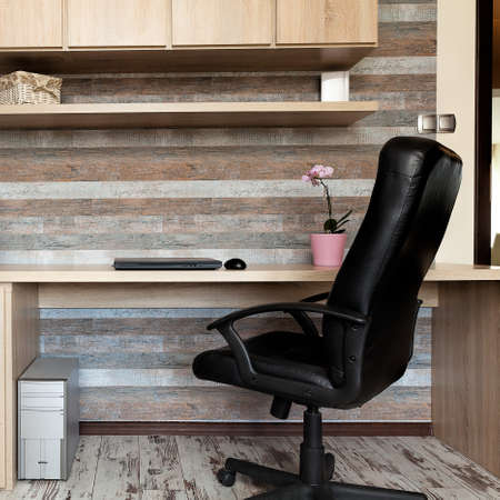 urban apartment: Urban apartment - modern office with a wooden desk Stock Photo