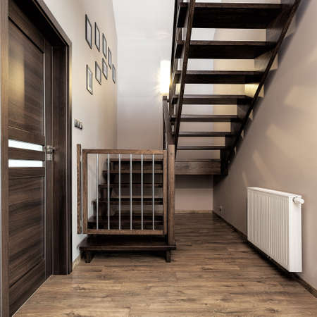 urban apartment: Urban apartment - wooden stairs with baby safety gate